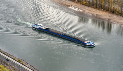 Coal freighter with reduced shipload on river Rhine with low water level, caused by drought 2018, by Boppard, Germany