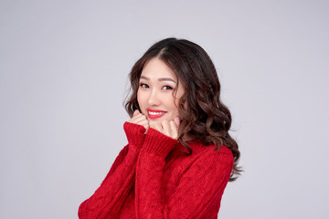 Portrait of beauty winter asian girl in red knitted woolen dress. Christmas Holiday.