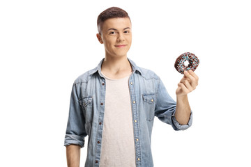 Young man holding a chocolate donut
