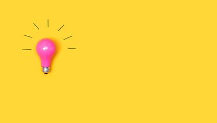 Wall Mural - Idea light bulb on a vivid yellow background