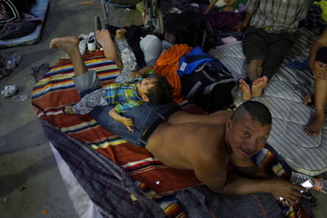 Migrants at a provisional shelter in Irapuato