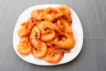 Boiled shrimps on a white plate.
