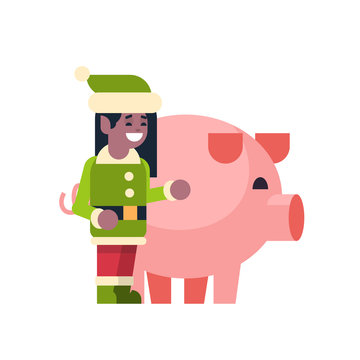 Elf girl Santa Claus helper with pig