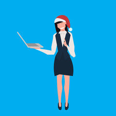 businesswoman wearing santa red hat using laptop female cartoon character full length blue background flat vector illustration