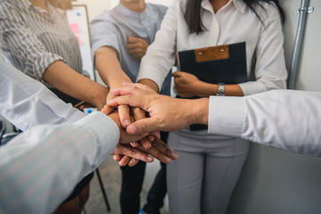 People with their hands together. Business team work concept.Friends with stack of hands showing unity and teamwork.