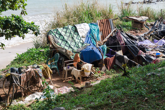 Place to stay and for life of homeless people, near sea beach. Concept of poverty and deprivation, social problems with housing shortage. Use garbage and waste for housing equipment. Sri lanka, Asia.