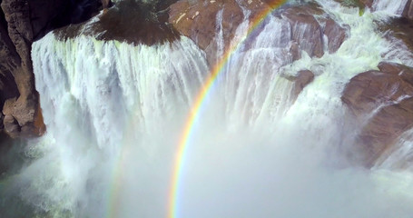 Shoshone Falls, Idaho, USA - Overhead Aerial View Looking Down Into Misty Waterfalls With Rainbow