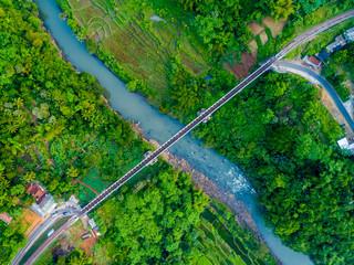 Scenic Aerial View of Cirahong Bridge, A Double Deck Structure of Metal Railway Bridge and Car Bridge Underneath Made by Dutch Colonial, Manonjaya Tasikmalaya, West Java Indonesia, Asia