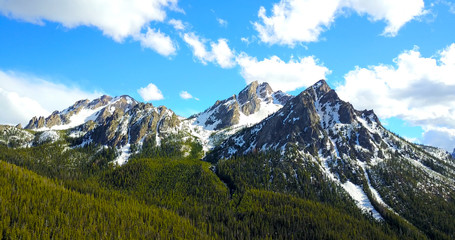 Sawtooth Mountains Idaho - Drone Aerial View Of Jagged Snowy Peaks With Pine Trees On The Slopes