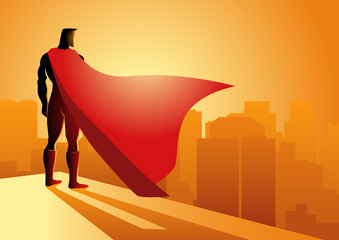 Superhero standing on the edge of a building