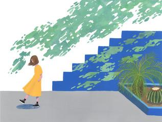 木陰で俯く女性