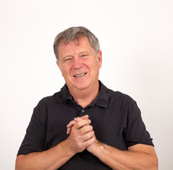 mature man in black shirt looking friendly