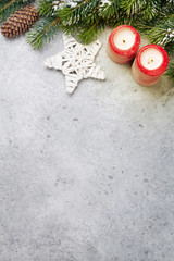 Christmas decor, candles and fir tree branch