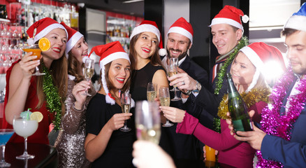 Friendly collective on corporate new year party in bar