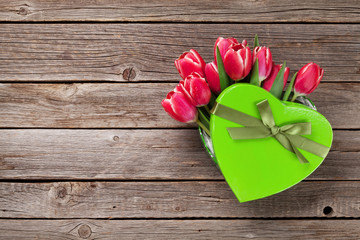 Red tulip flowers bouquet in heart gift box