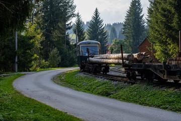 old wood log railway with train