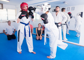 Women practicing at taekwondo class