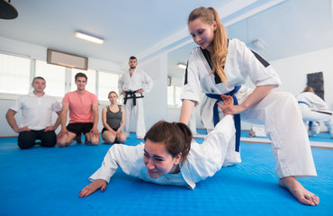 Females are training in pair to use taekwondo technique