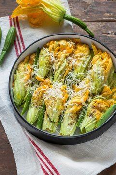 Stuffed squash blossoms with cheese in casserole