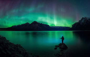 Aurora borealis over Lake Minnewanka, Banff National Park, Alberta, Canada