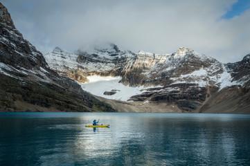 Kayaker in Lake O'Hara, Yoho National Park, Alberta, Canada