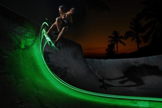 Shot of a guy skateboarding in a night skate park
