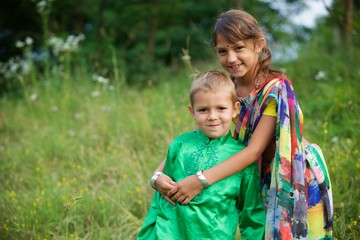 A lot of small children, boys and girls, dressed in the clothing culture of India.