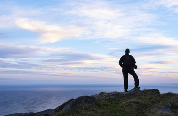 Hiker on top of Mount Jaizkibel with the sea in the background, Euskadi