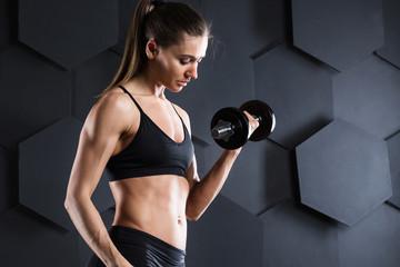 Athlete bodybuilder girl workout.