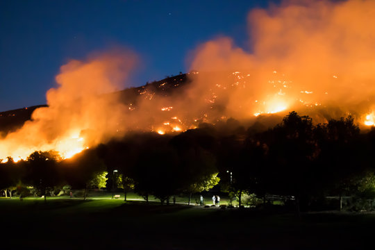 Hill on Fire Just Behind Suburban Park at Night during California Woolsey Brushfire