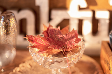 Bright colored maple leaves in crystal dish for Thanksgiving buffet