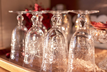 Closeup of vintage crystal glassware on the buffet, ready for holiday party