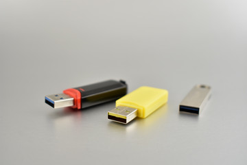Usb flash disk stock images. Various USB flash drive on a silver background. Colorful usb drives images