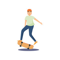 Young guy in a helmet rides a skateboard and performs various difficult stunts.
