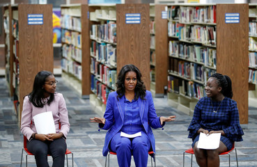 Former first lady Michelle Obama talks to students as she begins her book tour with a stop at the Whitney M. Young Magnet High School in Chicago