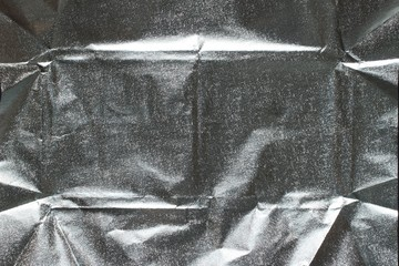 A silver wrapper of chocolate close-up