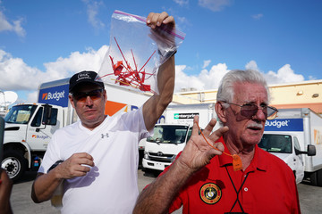 Men display plastic seals as they say were found outside Broward County election offices during a ballot recount in Lauderhill
