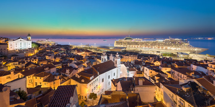 Old town of Lisbon, Portugal with docked cruise ship