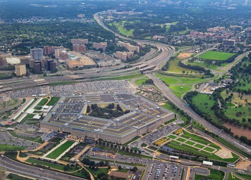 Aerial view of the United States Pentagon, the Department of Defense headquarters in Arlington, Virginia, near Washington DC, with I-395 freeway and the Air Force Memorial and Arlington Cemetery nearb