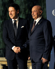Italy's Prime Minister Giuseppe Conte welcomes President of the eastern Libyan House of Representatives Aguila Saleh as he arrives to attend the first day of the international conference on Libya in Palermo
