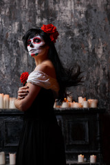 Photo of girl with white make-up and roses on face , arms crossed