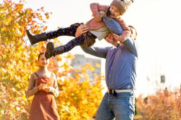 family in love walks in autumn park