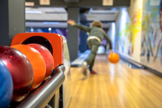 Child throwing bowling ball