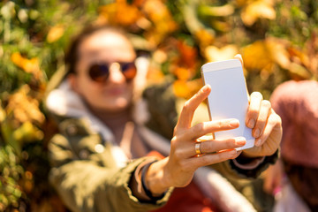 girl in the park in nature makes selfie