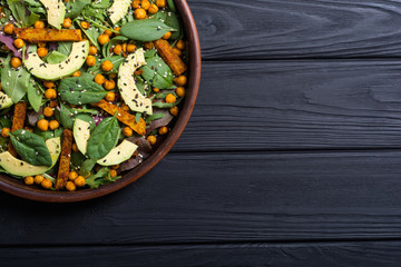 Baby spinach salad with sweet potato , chickpeas and avocado
