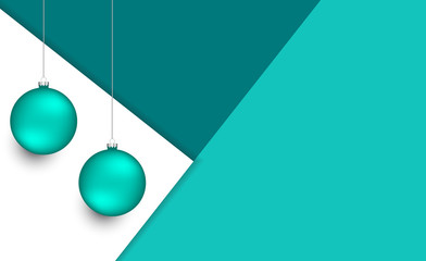 Colorful christmas balls on multiple layers of paper in top view. Christmas ornaments on cyan and blue paper sheets with space for text.