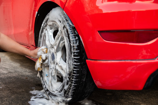 Cleaning red car, Automobile washing concept