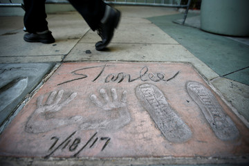 The handprints, footprints and signature of late Marvel Comics co-creator Stan Lee are pictured in the forecourt of the TCL Chinese theatre in Los Angeles