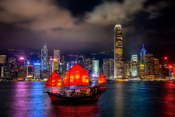 Fototapete - Victoria Harbour with junk ship at night in Hong Kong.