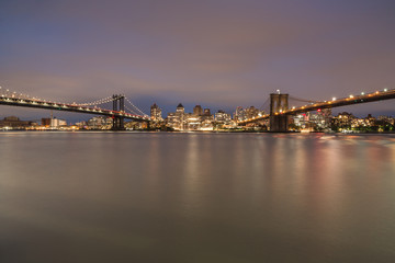 View on Dumbo location with Manhattan bridge and Brooklyn bridge from east river at night,long eposure photo